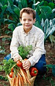 A boy with a basket of vegetables (outdoors)