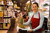 Sales assistant at supermarket till