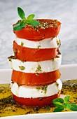 Tomato and mozzarella tower with basil and pesto