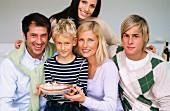 Family around birthday boy with birthday cake