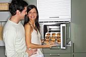 Couple baking muffins