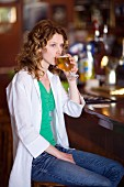 Woman sitting at a bar drinking beer