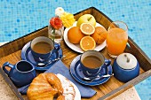 Tray of tea, croissants and orange juice