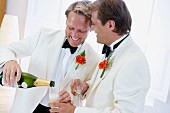 Same-sex, male couple celebrating wedding