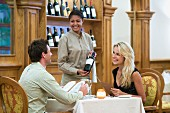 Couple choosing wine at a restaurant