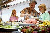 Father with children at buffet on holiday