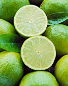 Two lime halves in a bed of limes