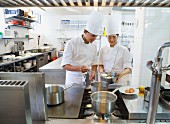 Chefs poaching an egg