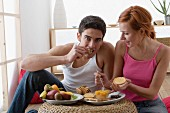 Couple eating fruit and rusks