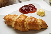 Croissant with jam and butter