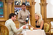 Couple selecting wine in restaurant