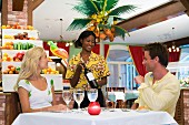 Couple selecting wine in restaurant
