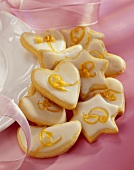 Biscuits of various shapes with lemon icing