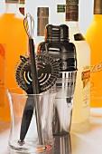 Bar utensils with bottles of spirits