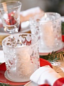 White windlights (Christmas table decoration)