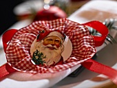Place-setting with napkin and Father Christmas