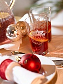 Glasses of punch with orange slices (Christmas)