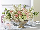 Romantic flower arrangement in a silver bowl