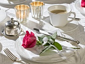 Coffee setting with red rose