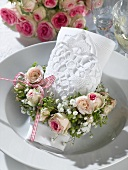 Romantic place-setting with napkin and flower wreath