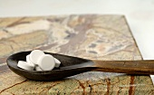 Schüssler Salts on wooden spoon