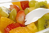 Fruit salad in a plastic box (close-up)