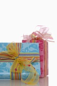 Two gifts tied with coloured ribbons