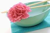 Asian bowl with chopsticks and flower
