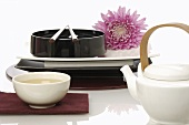 Asian place-setting, bowl of tea and teapot