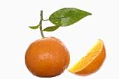 Whole orange and wedge of orange
