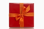 Gift in red wrapping paper with orange bow