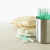 Cotton buds in a holder, exfoliating glove