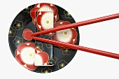 Flower-patterned Asian plate with chopsticks