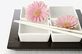 Dishes with chopsticks and flowers (Asia)