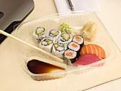 Sushi bento box on a desk