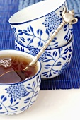 Tea in blue and white bowl with spoon (Asia)