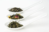 Three different sorts of tea in porcelain spoons