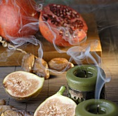 Pomegranates, dates and figs, smoking candles
