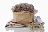 Wholegrain bread and cereal ears on tea towel