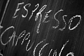 Blackboard with the words Espresso, Cappuccino written in chalk