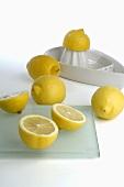 Citrus squeezer and lemons