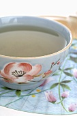 Tea in floral Asian teacup