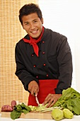 Asian chef chopping vegetables