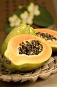 Papaya, halved, and carambola