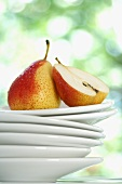 Forelle pears, whole and halved, on stacked plates