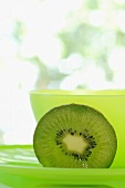 Kiwi fruit in front of green bowl