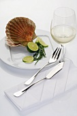Scallop with pieces of lime, glass of white wine