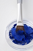 Blue powder with brush