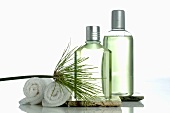 Two cosmetic bottles and towels