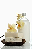 Soaps, body lotion and orchid flowers
